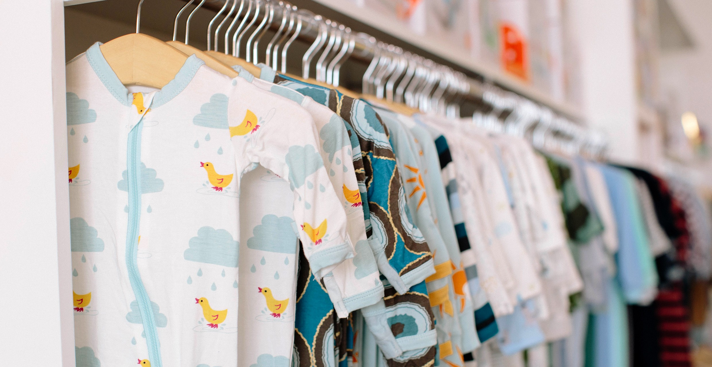 picture of baby clothing in a rack